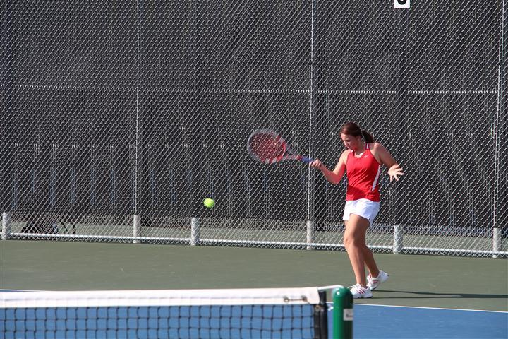 Molly Fisher, junior, hits a forehand shot and wins against the Flower Mound Jaguars.
