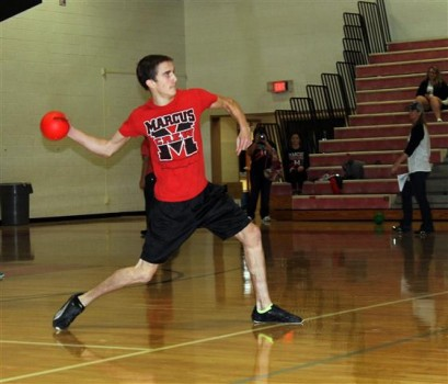 Senior Trevor Foust flings a dodgeball with all of his might.