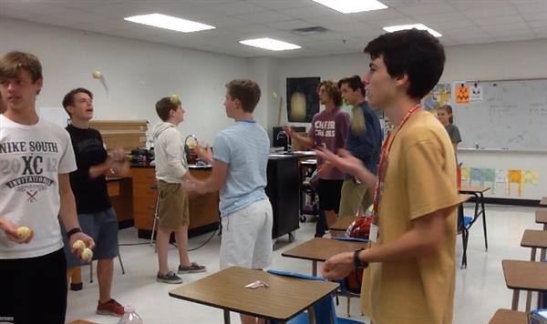 From left to right facing camera: Andrew Duffy 11, Logan Gutwein 12, and Alec Blair 11, practice their three-ball juggling skills in Scott Hinsley's classroom. They also juggle scarves and bowling pins.