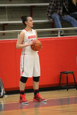Senior Taylor Roof inbounds the ball in a game against Plano Easton Jan. 30. The Marauders won the game 69-57.