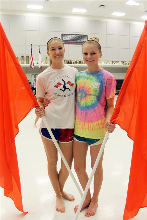 Seniors Jenny Hollowell (right) and Emily Plummer (left) were in colorguard for all four years of high school.