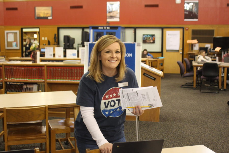 AP+Government+teacher+Carey+Petkoff+collects+the+finished+registration+forms.+She+hand+delivered+them+to+the+Denton+voting+office+for+students.