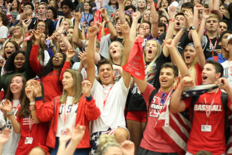 Students stand front row showing off their patriotic spirit wear.
