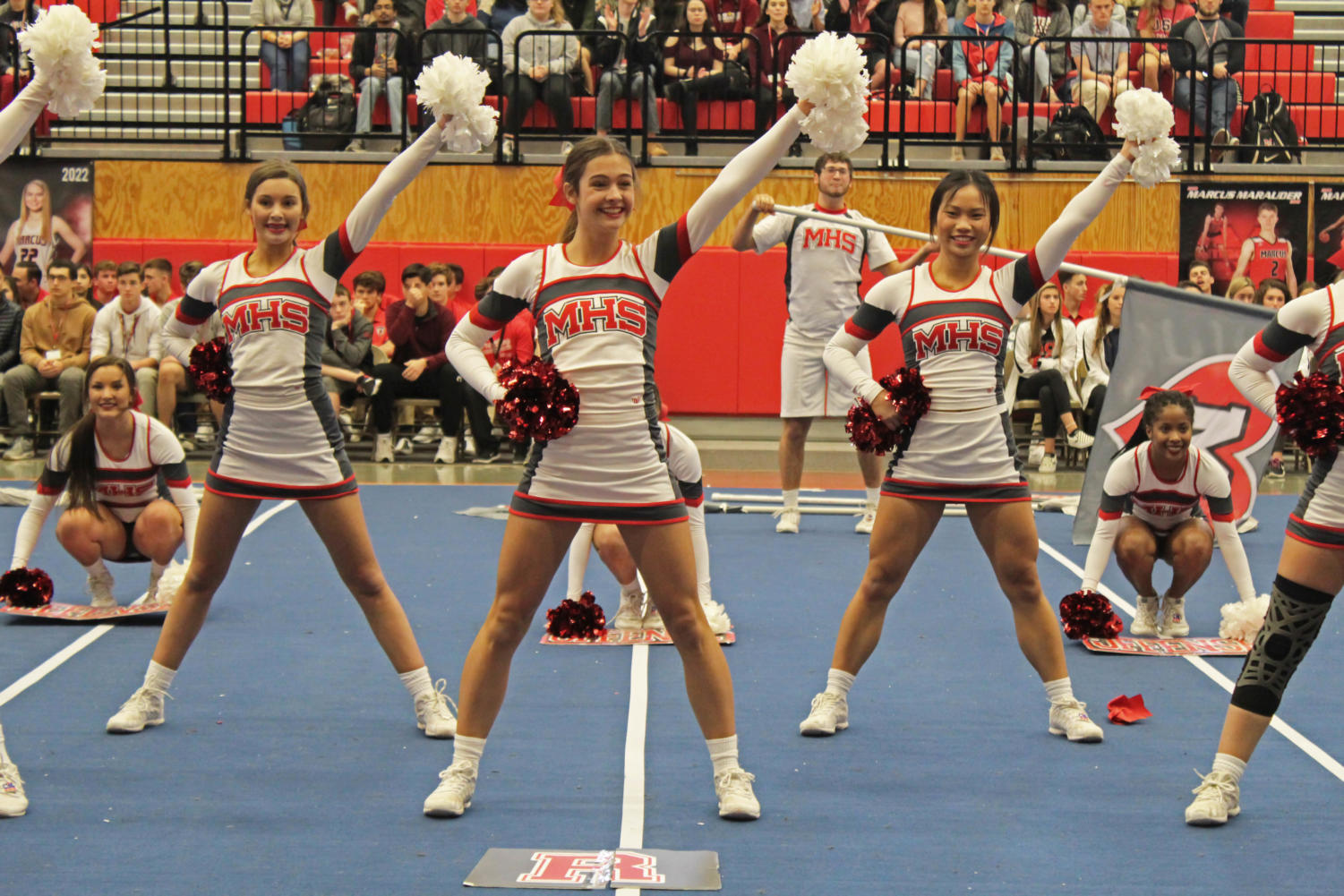 Sophomore Erin Bookout, junior Celine Toias and senior Ivana Tieu perform the second place routine at a pep rally. The cheerleaders don't perform full routines at events like football games, so the pep rally was an opportunity for the team to show off their hard work to other students.