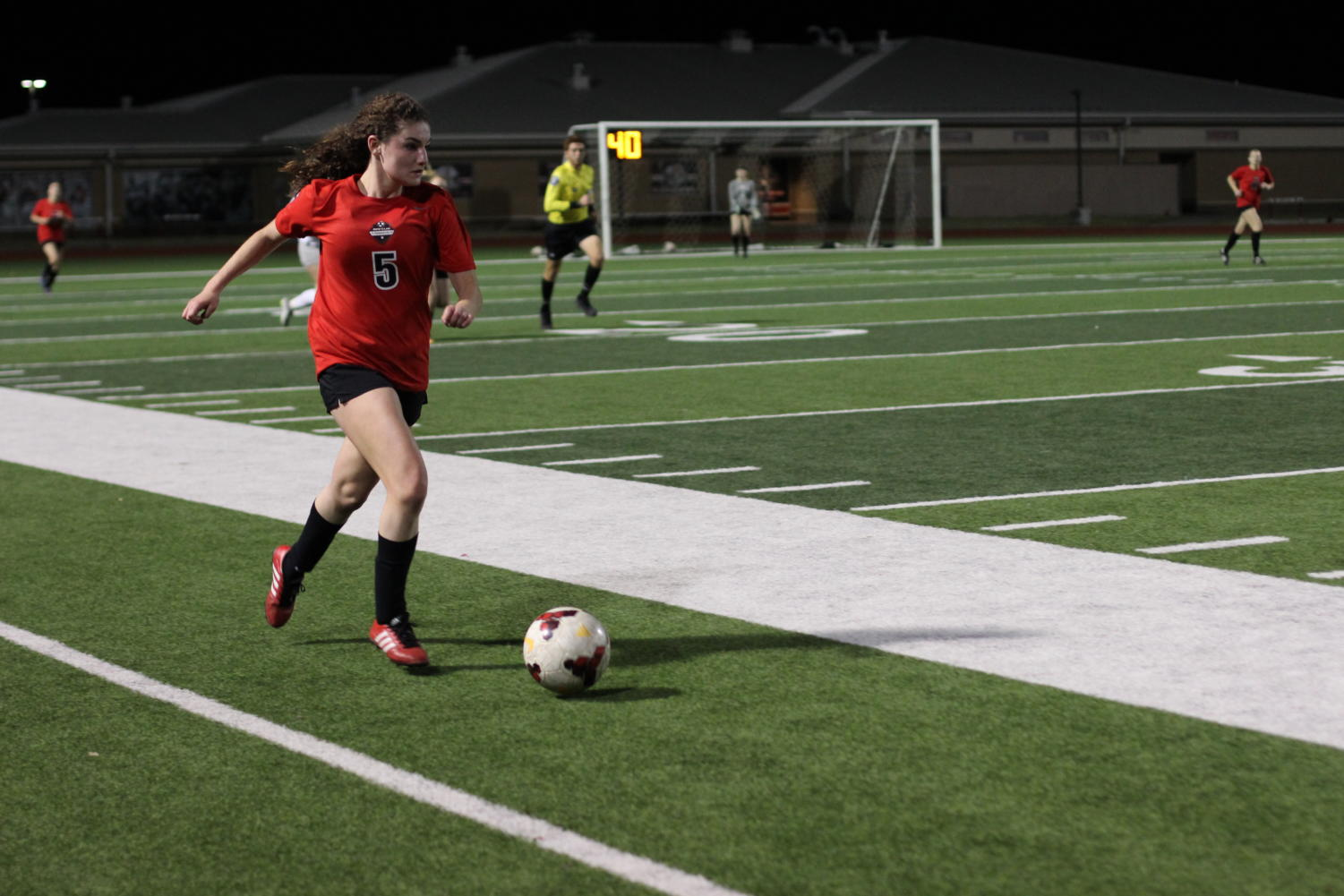 During the varsity game, sophomore Caroline Hilliard runs toward the goal. The team ended their season after their game against Byron Nelson on March 29.