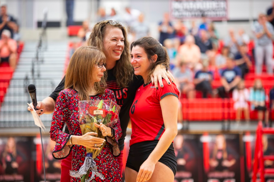 Wendy Smith was presented with the award after her daughter, junior Leila Smith, played in her volleyball game.