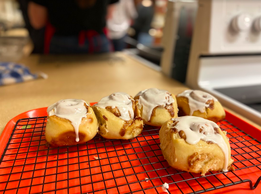 Mrs. Talley's food science class glazed their cinnamon rolls after taking them out of the oven. This lab lasted three days as they made the dough, cinnamon filling, and glaze all from scratch.