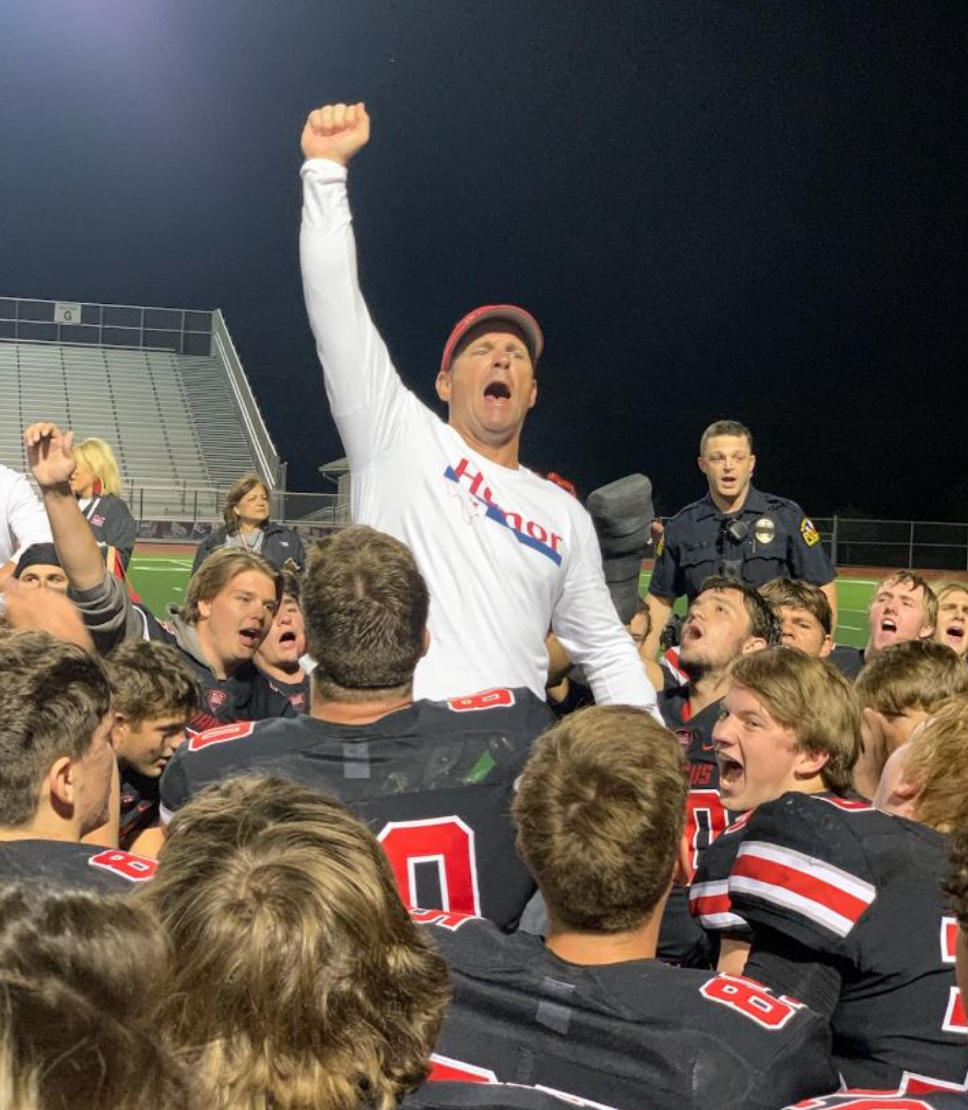 Head coach Kevin Atkinson celebrated with the team after their win against the Coppell Cowboys. Last week, the Marauders beat the Hebron Hawks 24-14.