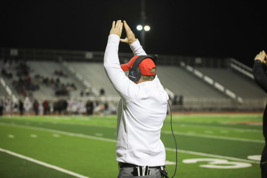 Head Coach Kevin Atkinson celebrated on the sidelines as his players got another win, securing Atkinson's 100th career victory.