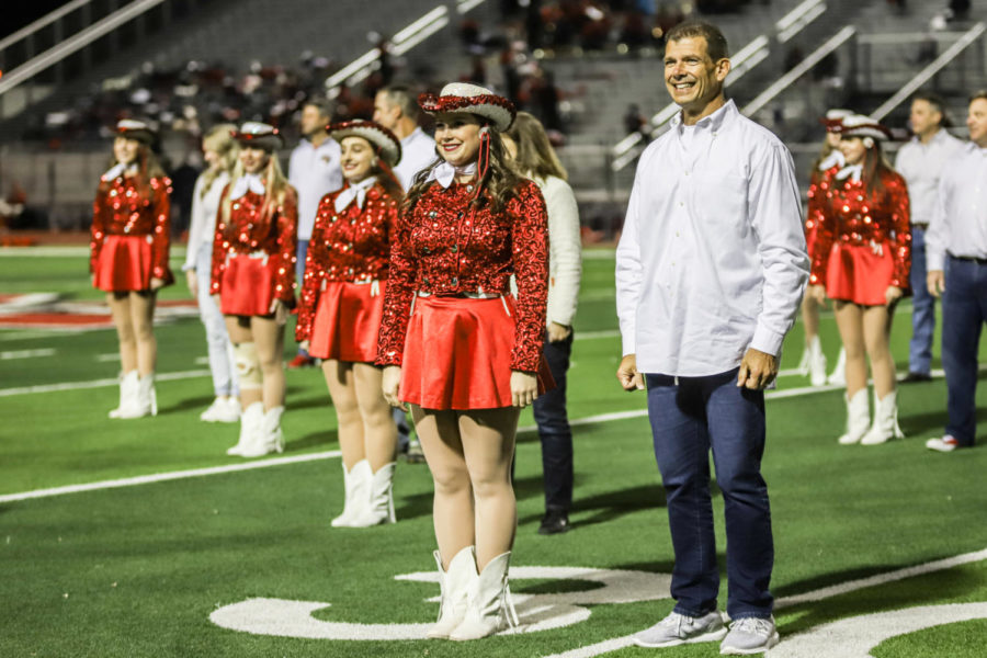The Marquettes performed a family dance at the game to celebrate senior night.