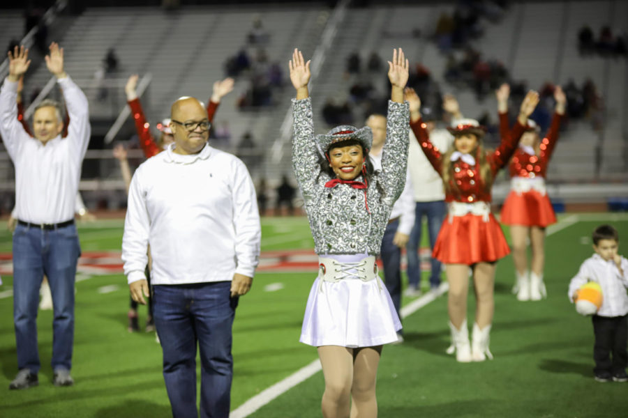 The Marquettes perform at every football game, and they were joined by family members for the game. Pictured is senior Marquette Officer Mariah Wheeler with her dad.