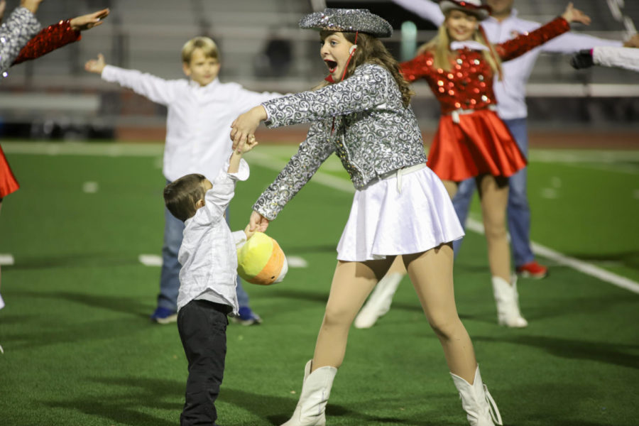 The Marquettes performed a routine with young kids during the game.