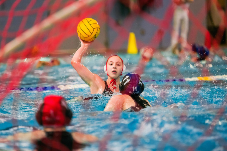 College freshman Kate Askew prepares to shoot the ball in a game against Guyer last season. Askew has taken the skills she has learned in high school and now plays water polo for Austin College.