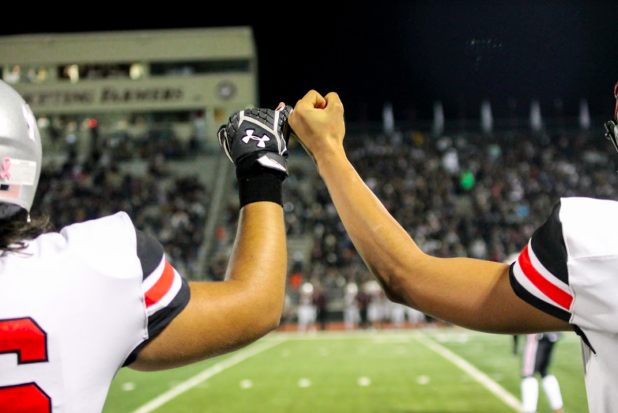 Players, coaches and spectators took part in the Marauder tradition of linking pinkies during the game.