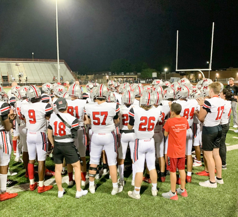 The Marauders huddled together after their loss to get pumped up for their next game.