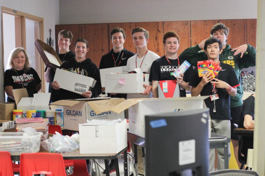 Student+advisory+board+members+junior+Ryan+Steen+and+seniors+Alec+McKisic%2C+Ethan+Lowry%2C+Corbin+Duncan%2C+Patrick+Black%2C+Joseph+Addicott+and+Steven+Sanfelippo+helped+organize+school+supplies+before+they+were+donated+to+Dallas+ISD.