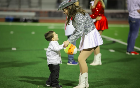 Junior Marquette officer Emily Reynolds performs during halftime at the football game against the Irving MacArthur Cardinals on Nov. 2. The Marauders won 49-13.