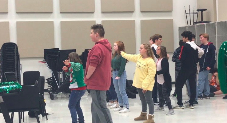 United Sound mentors and students play Just Dance at their Christmas party.