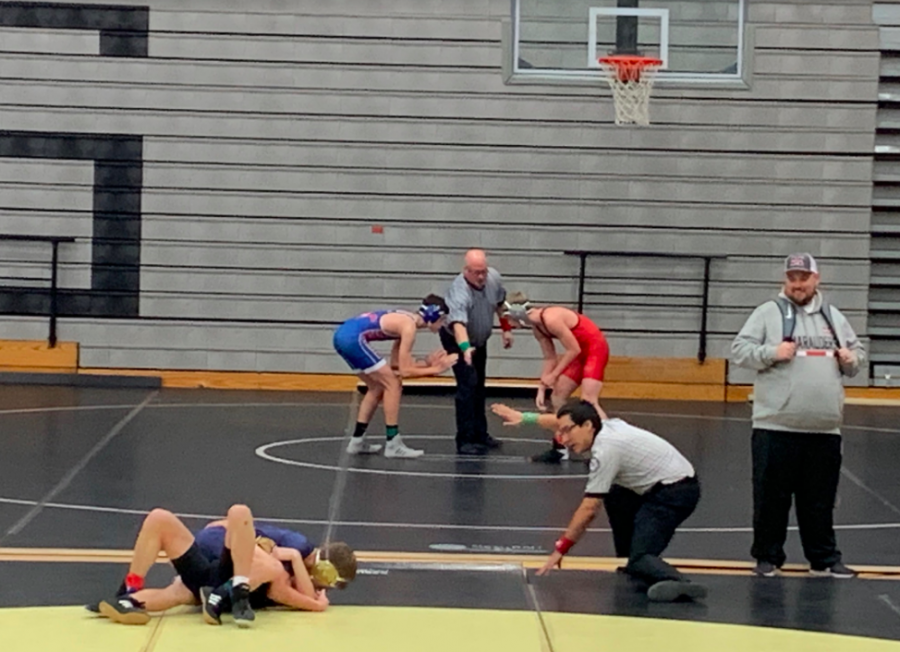 Freshman Ty Cowley waits for the referee to start the match against another wrestler from Hebron on Monday, December 16. The JV wrestling team has matches on Mondays.