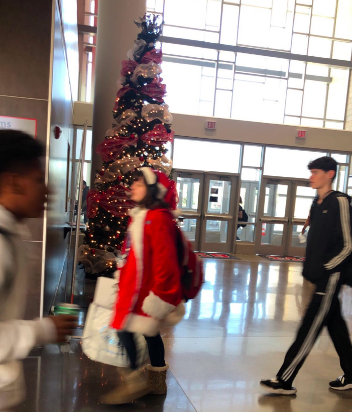Ninth grade campus students come together for the holidays and put up a tree near the front door entrance.