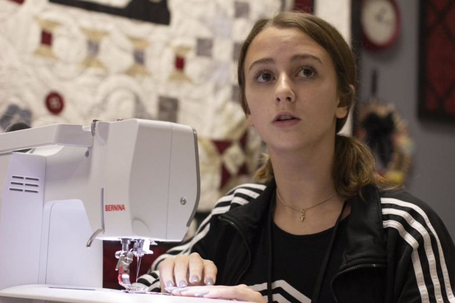 Sophomore+Katherine+Yezer+listens+to+Fashion+Design+teacher+Kim+Watson+as+she+instructs+the+class.+The+program+providing+stockings+to+families+was+created+by+CCA+a+year+ago.