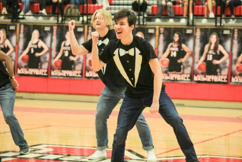 Senior Landon Bradley dances to popular songs with the rest of the Mr. Marcus contestants.