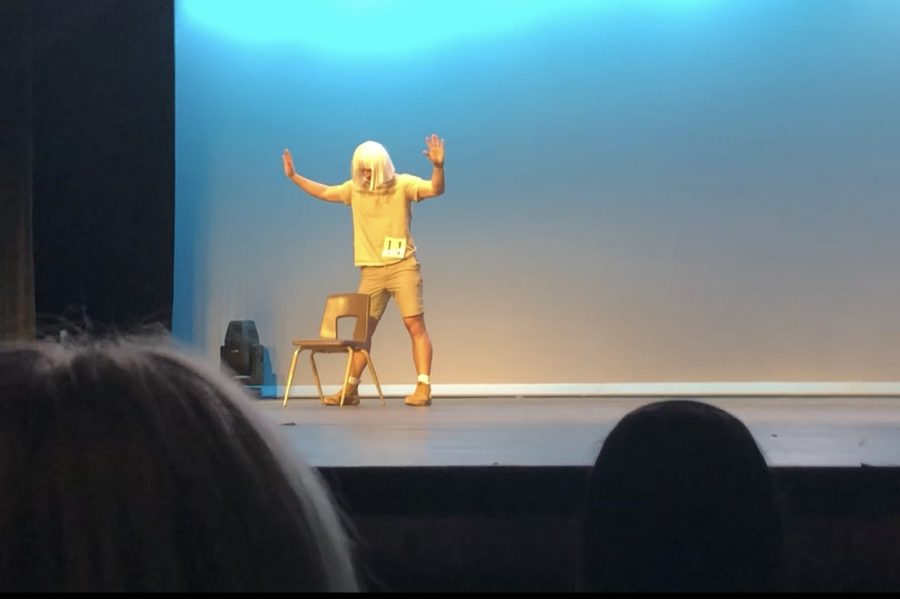 """Senior Ethan Barr performs a dance routine inspired by famous dancer Maddie Zeigler in the Mr. Marcus pageant on Feb. 20. This dance originally premiered in pop singer Sia's """"Chandelier"""" music video."""