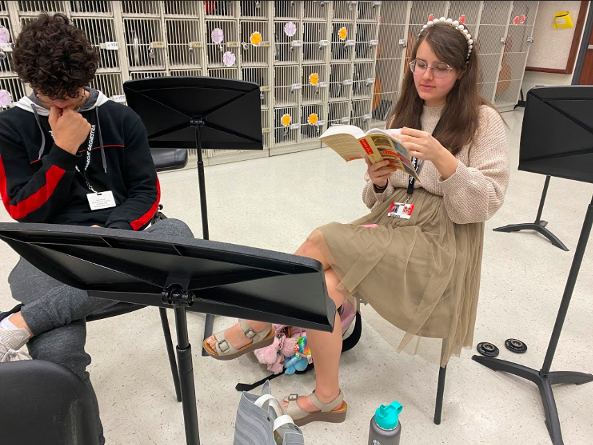 Junior Luca Nardielli and senior Anna Ryan relax inside the orchestra room before going to first period.