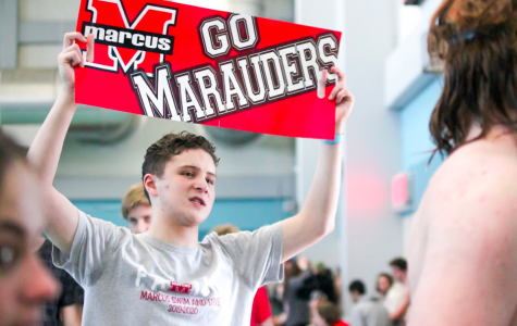 Junior Matthew Hill supports swim at their meet on Jan. 18. He and others encouraged teammates during their events.
