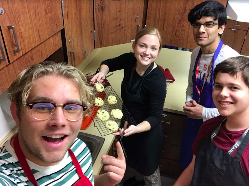 Seniors Chance Castleberry and McKenna Cowley bake cookies with juniors Anshul Gowda and Alastair Cockram in food science.