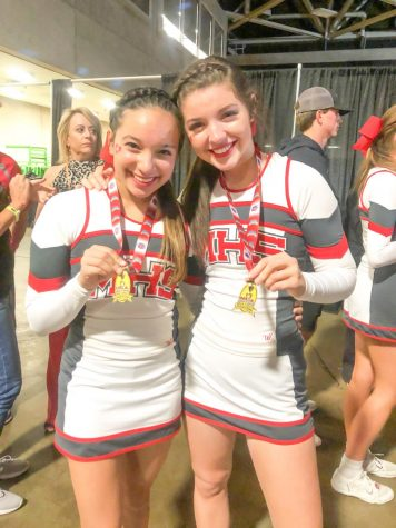"Juniors Yasmeen Siddiqi and Natalie de Berjeois pose together with their medals. The cheerleading team performed to a remix of ""I Love Rock and Roll"" for part of their routine where they changed the words ""rock and roll"" to ""Marcus."""