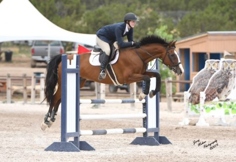 Senior Ashleigh Jooste guides her horse, Max, over a jump at a 2019 competition. She plans to study to become a large animal vet in the future.