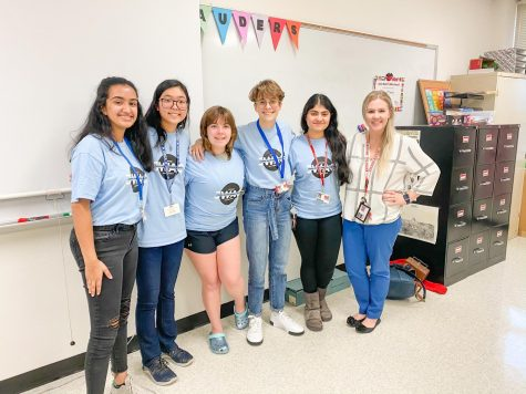 Officers Angela Abraham, Fiona Chung, Destiny Simpson, Renee Gomez, Neha Yawalkar, and sponsor Kaitlyn Wilson stand together. They discussed education in third world countries during the February meeting.