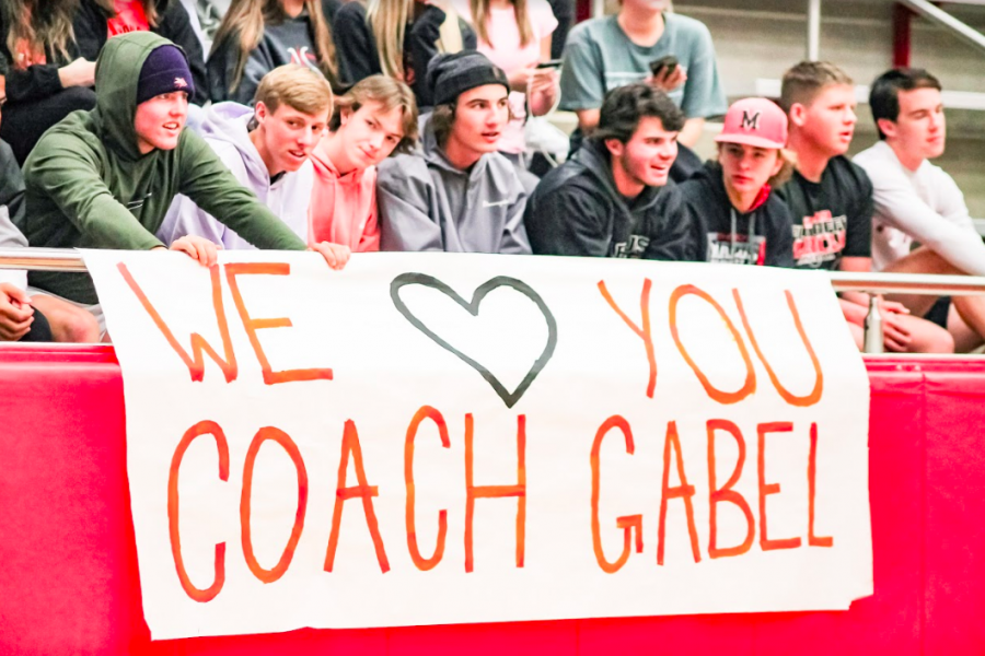 Posters were hung around the school to announce the game and honor golf coach Kerry Gabel. Coaches and members of the boys teams cheered on the girls during their game, and also had a game afterwards to support Gabel.
