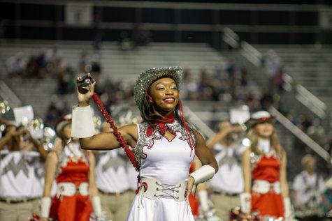 Senior Marquette officer Mariah Wheeler performs in front of the crowd during the Sept. 13 football game.