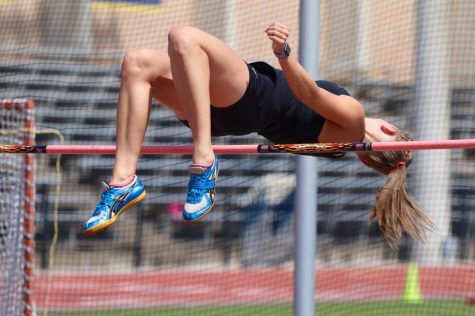 Senior Maddie Meiner high jumps 5 feet 8 inches at a meet her junior year, tying the school record.