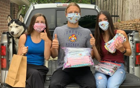 Junior Maddie Felan (left) recently started the non- profit organization All in for Children with her brother, Nick Felan (center), and his girlfriend, Elizabeth Garcia Creighton (right). The group sews masks for children in hospitals.