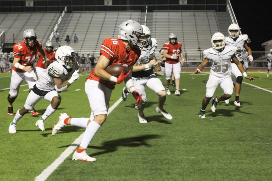 Senior Tyler Schott runs with the ball while keeping his eyes on the Prosper players around him.