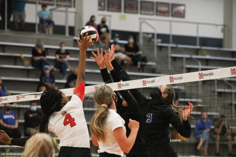 Junior Ifenna Cos-Okpalla jumps to block the ball.