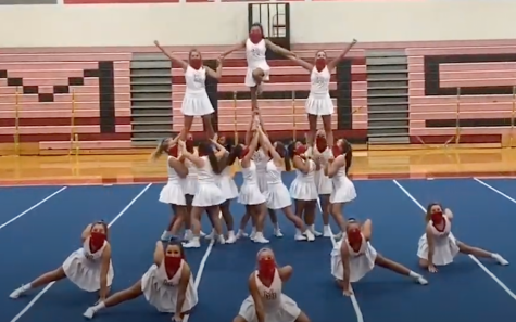 A screenshot from the virtual pep rally shows the cheerleaders performing a routine while wearing face coverings.