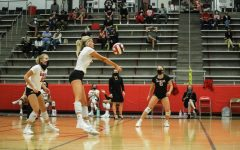 Senior Abby Ekeler sends the ball back over to the Lewisville Farmers. The Marauders won the home conference match 3-0.