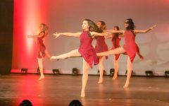 Senior Tristan Finn performs a contemporary piece, her favorite genre of dance, at the Marquettes Spring Show her sophomore year. Joining the Marquettes helped Tristan find a love for dance again after leaving a ballet studio.