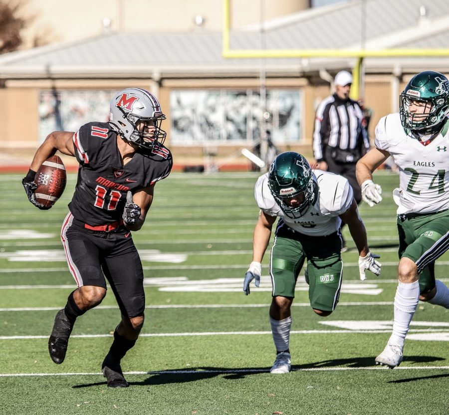 Junior wide receiver and defensive back Dallas Dudley runs away from the Prosper Eagles in an attempt to score points in the final minutes of the game.