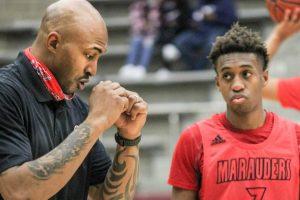 Assistant Basketball Coach James Singleton instructs junior Christian Weddington during the game on Feb. 2.