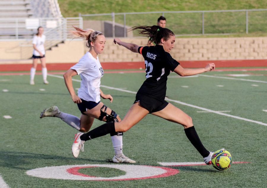 Senior Leah Roulston attempts to score a goal during the game on April 6, which Marcus won 3-0 against the Keller Indians.