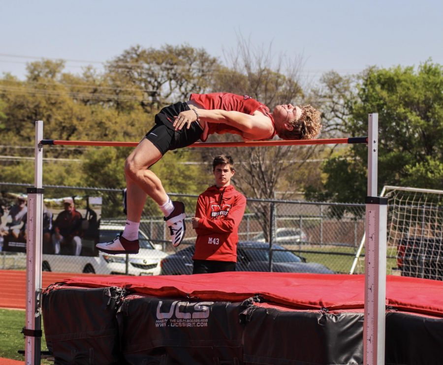 Senior Blake Bradford successfully completes the high jump during the Steve Telaneus Invitational on April 1.