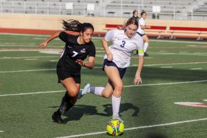 Sophomore Bella Campos chases after the ball before stealing it back for her team.
