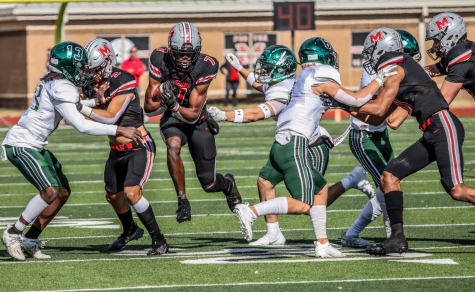 Senior wide receiver J. Michael Sturdivant runs past Prosper players after catching the football.