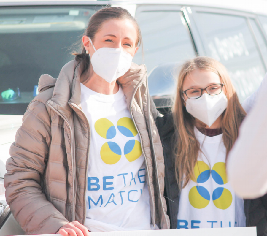 Briarhill Middle School student Audrey Gronberg and her mother, Kim, welcomed donors during the bone marrow drive on Jan. 9. Over 300 people drove through to register as donors.