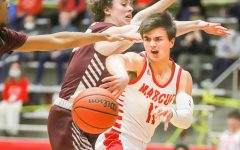 Senior Nick Donnelly dodges Plano opponent as he passes the ball to his teammate. The team won the game 65-43.